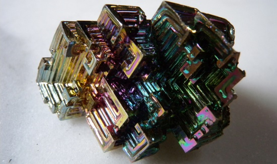 Ultrapure bismuth forms hopper crystals when coolomg from the melt. A thin oxide layer forms, creating interference colors. All photos in this set are of the same specimen.